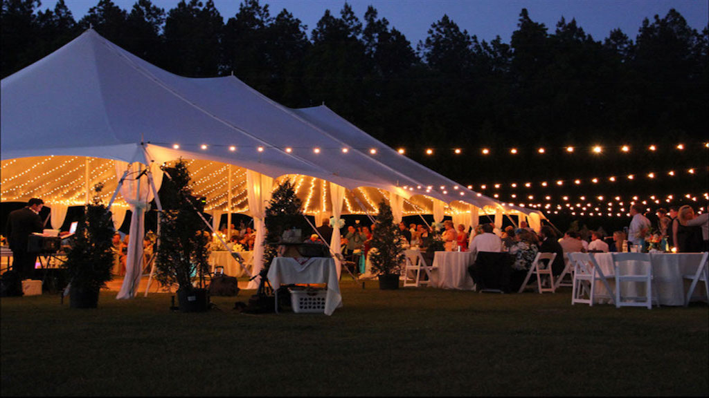 Frungillo-Off-Premise-evening-wedding-reception-tent-string-lighting-bistro-catering
